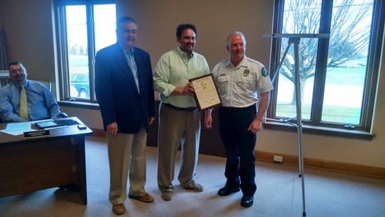 Chief Wallis & Chairman Hultquist accepting the safest City Award from Joel Kleefisch April 2016