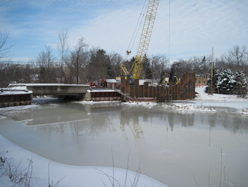 Installation of new sheet piling in front of mill race